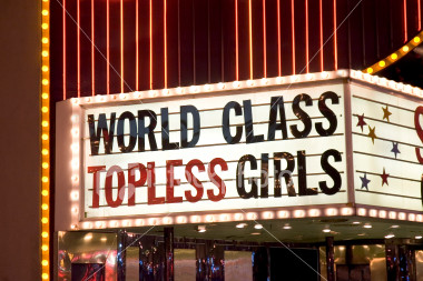 ist2_605607_topless_girls_sign_outside_strip_club