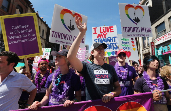 the Toronto Gay Pride Parade with attracts a million people who line the route