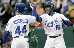 Kansas City Royals' Reggie Sanders (16) is congratulated by