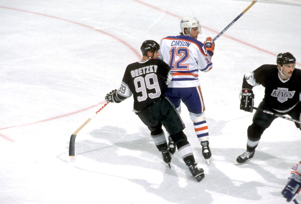 Hockey: Edmonton Oilers Jimmy Carson (12) in action vs Los Angeles Kings Wayne Gretzky (99) at Northlands Coliseum.Edmonton, Canada 10/19/1988CREDIT: David E. Klutho (Photo by David E. Klutho /Sports Illustrated/Getty Images)(Set Number: X37263 TK3 R5 F21 )