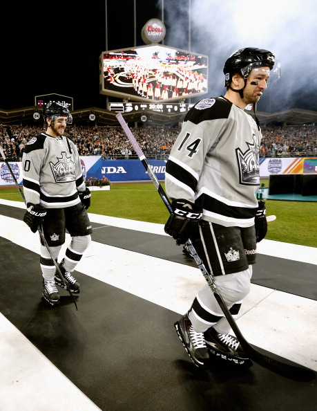LOS ANGELES, CA - JANUARY 25: Mike Richards #10 (L) and Justin Williams #14 (R) of the Los Angeles Kings enter Dodger Stadium to take on the Anaheim Ducks in 2014 Coors Light NHL Stadium Series game on January 25, 2014 in Los Angeles, California. (Photo by Gregory Shamus/NHLI via Getty Images)
